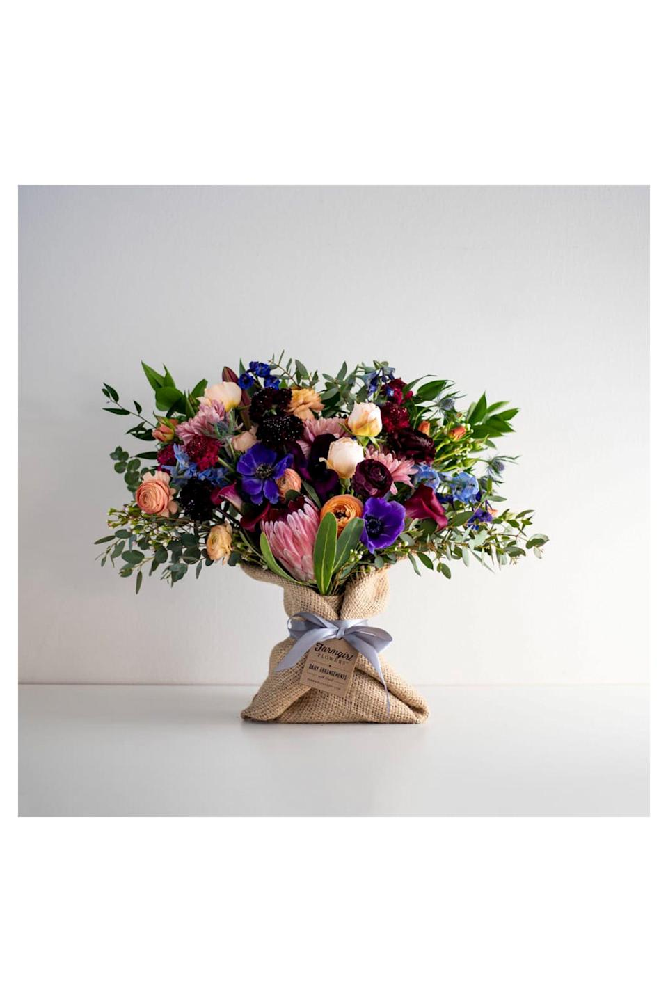 """<p><strong>Farmgirl Flowers </strong></p><p>farmgirlflowers.com</p><p><strong>$99.00</strong></p><p><a href=""""https://farmgirlflowers.com/big-love-burlap-wrapped-bouquet"""" rel=""""nofollow noopener"""" target=""""_blank"""" data-ylk=""""slk:Shop Now"""" class=""""link rapid-noclick-resp"""">Shop Now</a></p><p>Designed with love and wrapped in reused burlap coffee bags from local roasters (hello sustainability!), <a href=""""https://farmgirlflowers.com/"""" rel=""""nofollow noopener"""" target=""""_blank"""" data-ylk=""""slk:Farm Girl Flowers"""" class=""""link rapid-noclick-resp"""">Farm Girl Flowers</a> sources their flowers ethically and honestly with nationwide shipping. </p>"""