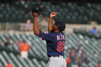 Minnesota Twins relief pitcher Jorge Alcala reacts to the final out in the ninth inning of a baseball game against the Detroit Tigers in Detroit, Thursday, Sept. 26, 2019. (AP Photo/Paul Sancya)
