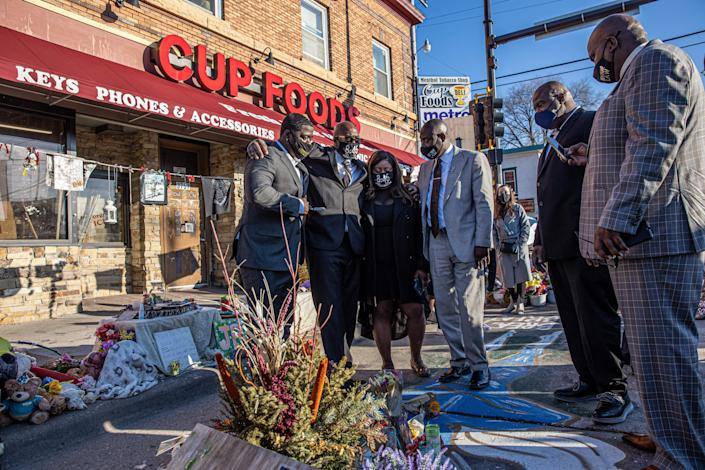 George Floyd's family, including brother Philonise Floyd (2nd L), and Floyd family lawyer Ben Crump (R) visit a memorial on March 12 at the site where George Floyd died in Minneapolis. (Photo by Kerem Yucel / AFP) (Photo by KEREM YUCEL/AFP via Getty Images) (Photo: KEREM YUCEL via Getty Images)