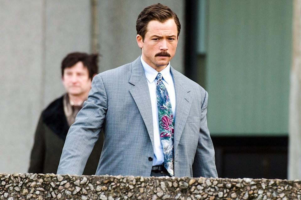 <p>Taron Egerton, who plays real-life game developer Henk Rogers, is spotted in character filming a scene for <em>Tetris</em> on Sunday in Aberdeen, Scotland.</p>