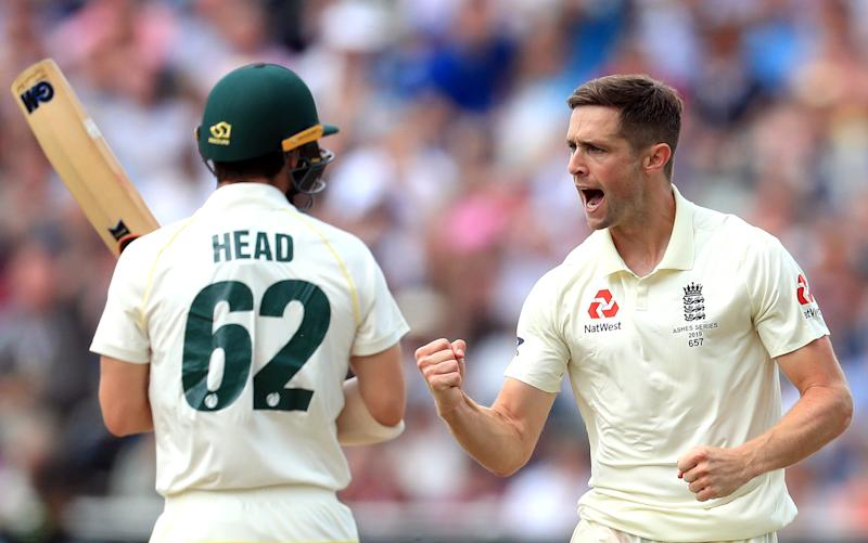 England's Chris Woakes (right) celebrates taking the wicket of Australia's Travis Head during day one of the Ashes Test match at Edgbaston, Birmingham. (Photo by Mike Egerton/PA Images via Getty Images)