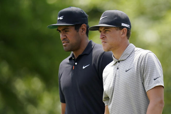 Tony Finau and Cameron Champ, right, watch as Kris Ventura and Viktor Hovland of Norway play the second hole during the third round of the PGA Zurich Classic golf tournament at TPC Louisiana in Avondale, La., Saturday, April 24, 2021. (AP Photo/Gerald Herbert)