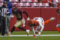 Washington Football Team running back Antonio Gibson (24) runs past Cincinnati Bengals linebacker Germaine Pratt (57) during the first half of an NFL football game, Sunday, Nov. 22, 2020, in Landover. (AP Photo/Susan Walsh)