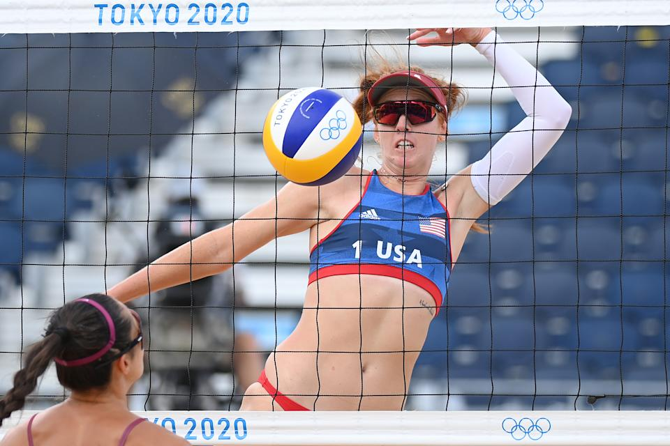 <p>Kelly Claes #1 of Team United States attacks against Team Latvia during the Women's Preliminary - Pool D beach volleyball on day three of the Tokyo 2020 Olympic Games at Shiokaze Park on July 26, 2021 in Tokyo, Japan. (Photo by Matthias Hangst/Getty Images)</p>
