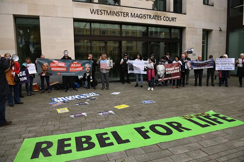 A banner with the Extinction Rebellion slogan has been unfurled in front of the court. It reads: