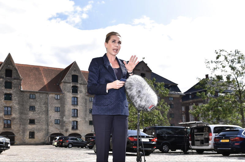 "Denmark's Prime Minister Mette Frederiksen makes a comment on US President's cancellation of his scheduled State Visit, in front of the State Department in Copenhagen, Wednesday, Aug. 21, 2019. U.S. President Trump announced his decision to postpone a visit to Denmark by tweet on Tuesday Aug. 20, 2019, after Danish Prime Minister Mette Frederiksen dismissed the notion of selling Greenland to the U.S. as ""an absurd discussion."" (Mads Claus Rasmussen / Ritzau Scanpix)"