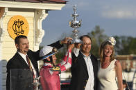 Rombauer trainer Michael McCarthy, left, jockey Flavien Prat, second from left, and horse owners John Fradkin and Diane Fradkin hold the trophy after winning the 145th Preakness Stakes horse race at Pimlico Race Course, Saturday, May 15, 2021, in Baltimore. (AP Photo/Will Newton)