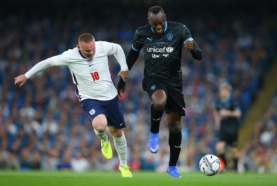 Usain Bolt holds off the challenge of Wayne Rooney during Soccer Aid (Getty Images)