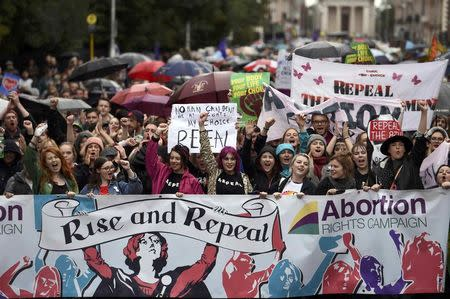 Demonstrators take part in a protest to urge the Irish Government to repeal the 8th amendment to the constitution, which enforces strict limitations to a woman's right to an abortion, in Dublin, Ireland September 24, 2016. REUTERS/Clodagh Kilcoyne