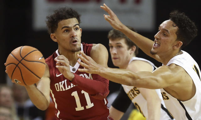 Oklahoma guard Trae Young (L) looks for a pass while Wichita State guard Landry Shamet defends. (Travis Heying/The Wichita Eagle via AP)