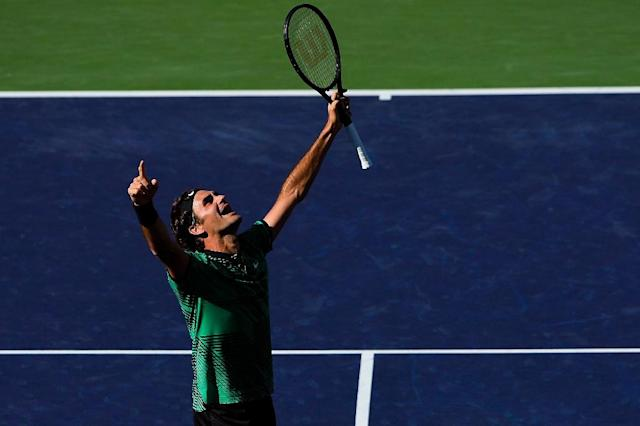 Roger Federer of Switzerland celebrates after defeating compatriot Stan Wawrinka in the ATP Indian Wells final match, in California, on March 19, 2017 (AFP Photo/Alex Goodlett)