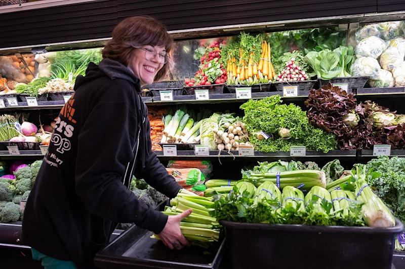 Woman restocking produce at Weavers Way Co-op in Philadelphia (Weavers Way Co-op)