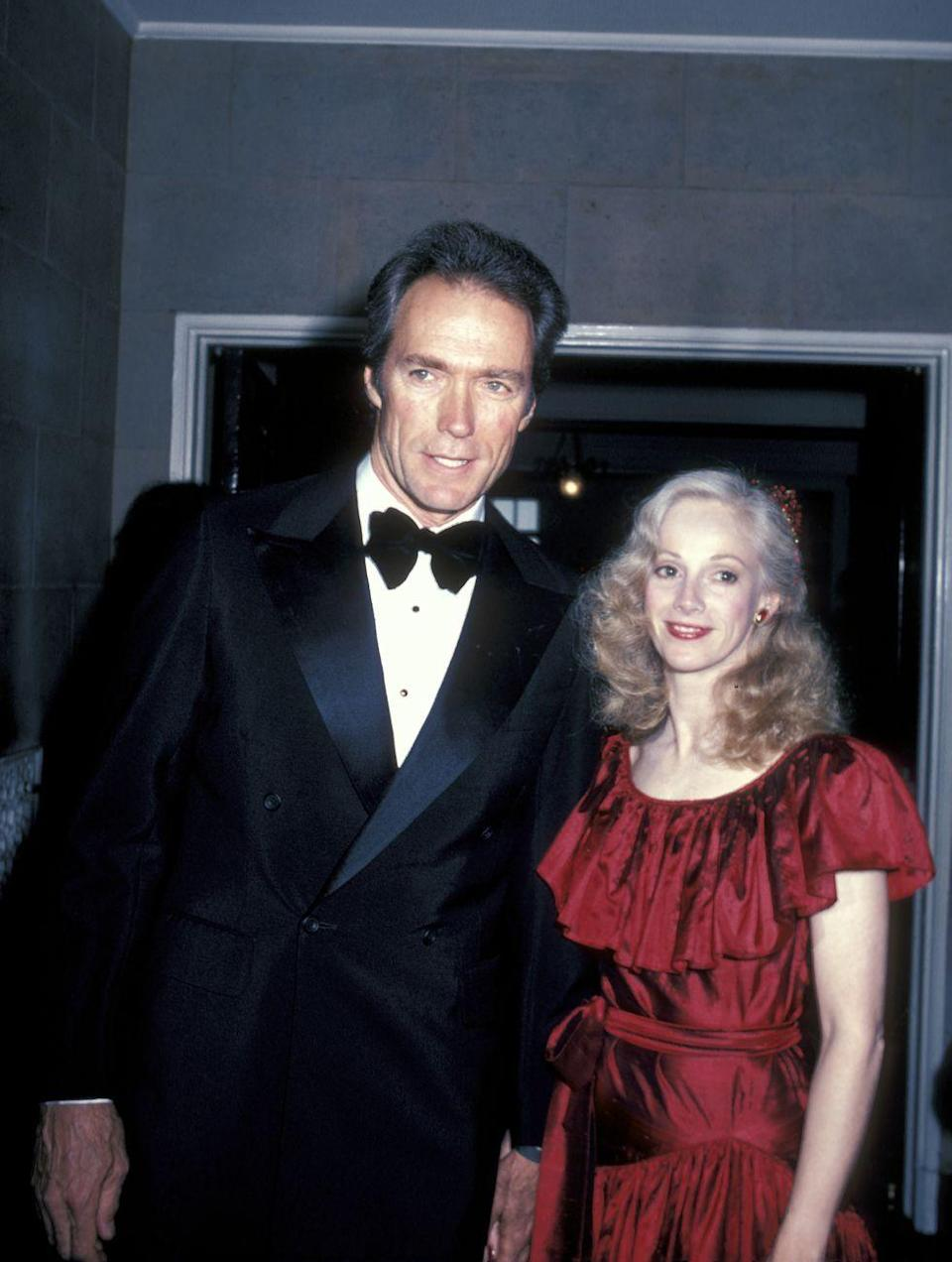 "<p>Actress Sondra Locke and Eastwood struck up a romance on the set of <em>The Gauntlet</em>. Even though Eastwood wasn't divorced from Johnson yet, he moved <a href=""https://abcnews.go.com/Entertainment/clint-eastwoods-women/story?id=20235215"" rel=""nofollow noopener"" target=""_blank"" data-ylk=""slk:into a Bel-Air home with her"" class=""link rapid-noclick-resp"">into a Bel-Air home with her</a>. They were together for 12 years, during which time they made four films together.</p>"