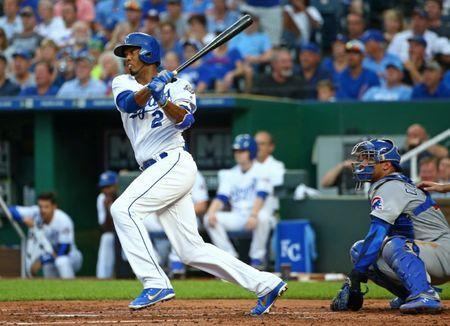 FILE PHOTO: Aug 6, 2018; Kansas City, MO, USA; Kansas City Royals shortstop Alcides Escobar (2) hits an RBI single against the Chicago Cubs in the second inning at Kauffman Stadium. Mandatory Credit: Jay Biggerstaff-USA TODAY Sports - 11036410