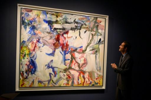 """An art expert from Sotheby's talks about Willem de Kooning's """"Untitled XXII"""" during an auction preview November 1, 2019 at Sotheby's in New York"""