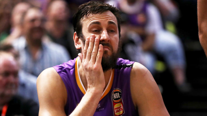 Andrew Bogut looks dejected on the bench for the Sydney Kings.