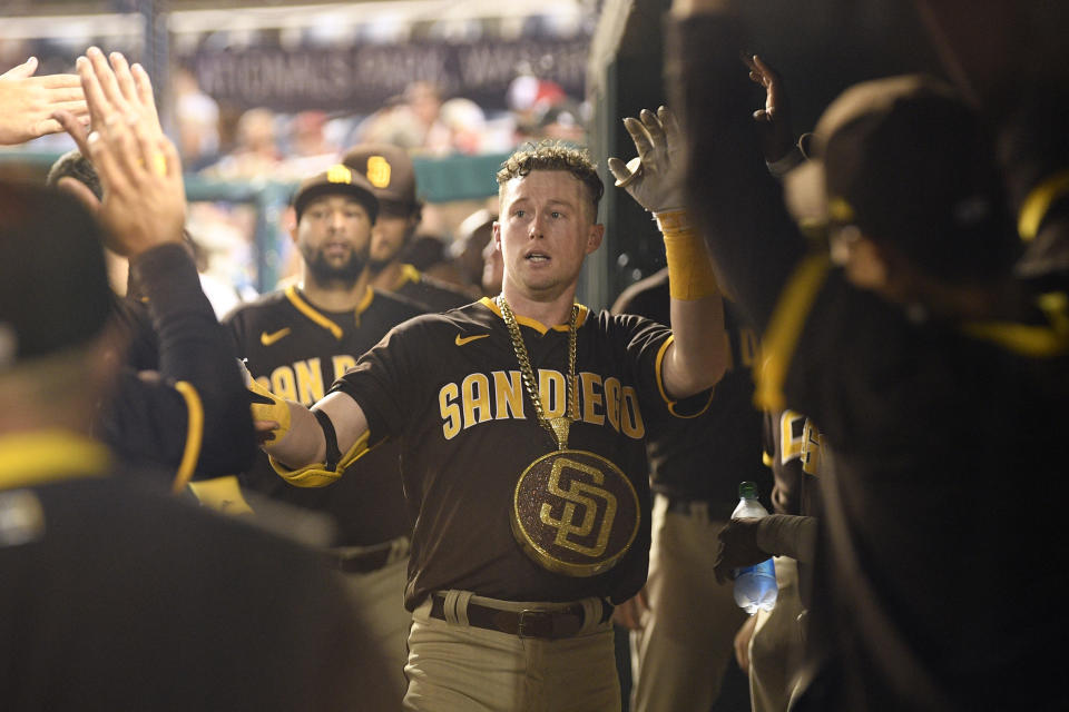 San Diego Padres' Jake Cronenworth celebrates in the dugout after his home run during the fifth inning of a baseball game against the Washington Nationals, Friday, July 16, 2021, in Washington. (AP Photo/Nick Wass)