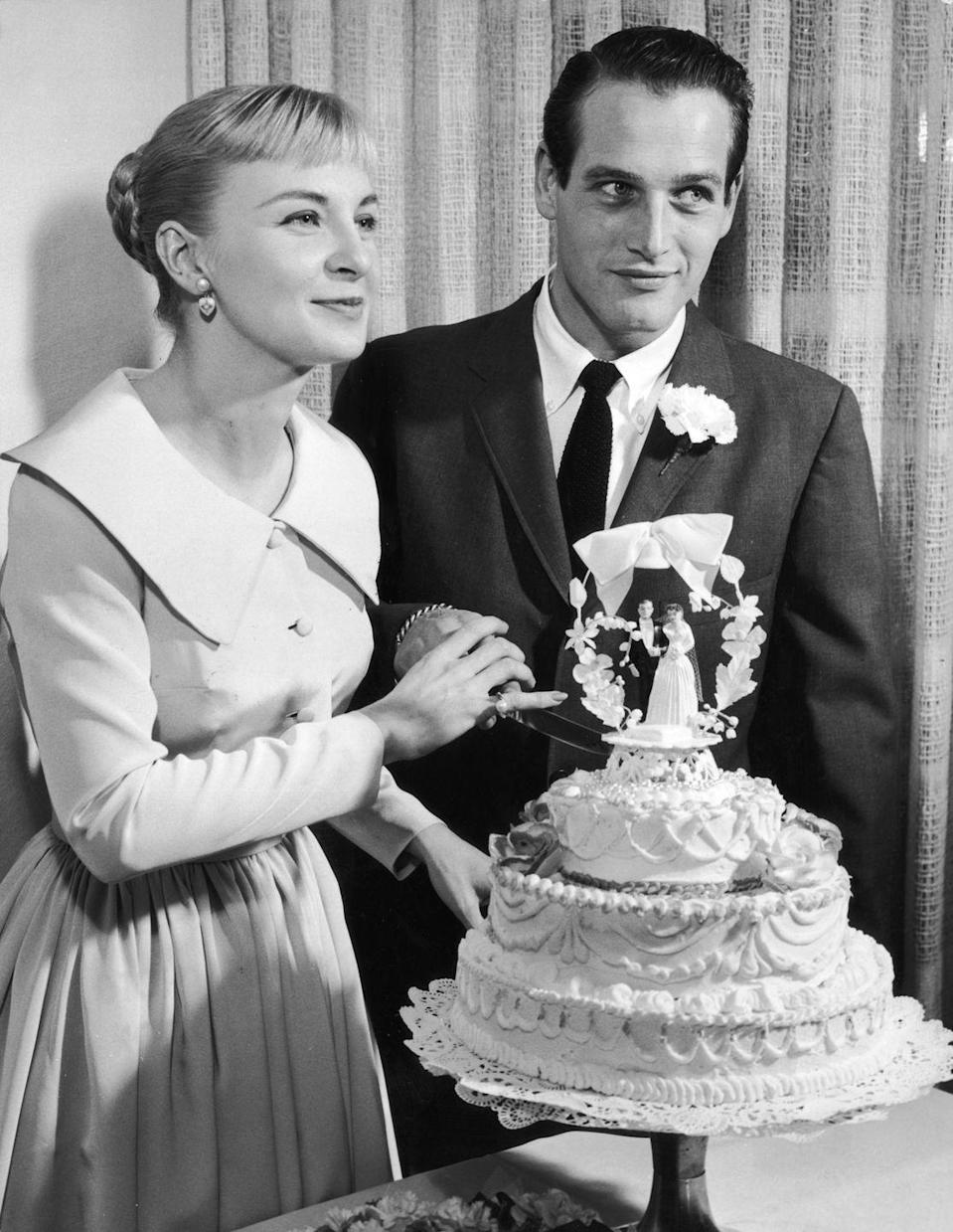 <p>Hollywood heavy hitters, Joanne Woodward and Paul Newman, pose with their wedding cake following a Las Vegas ceremony in 1958. The couple was married for 50 years. </p>