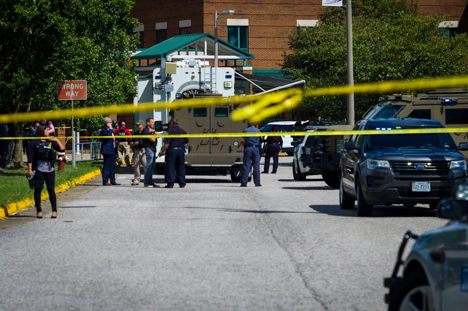 Police respond to the scene of a shooting at Heritage High School in Newport News, Va., on Saturday Sept. 20, 2021.