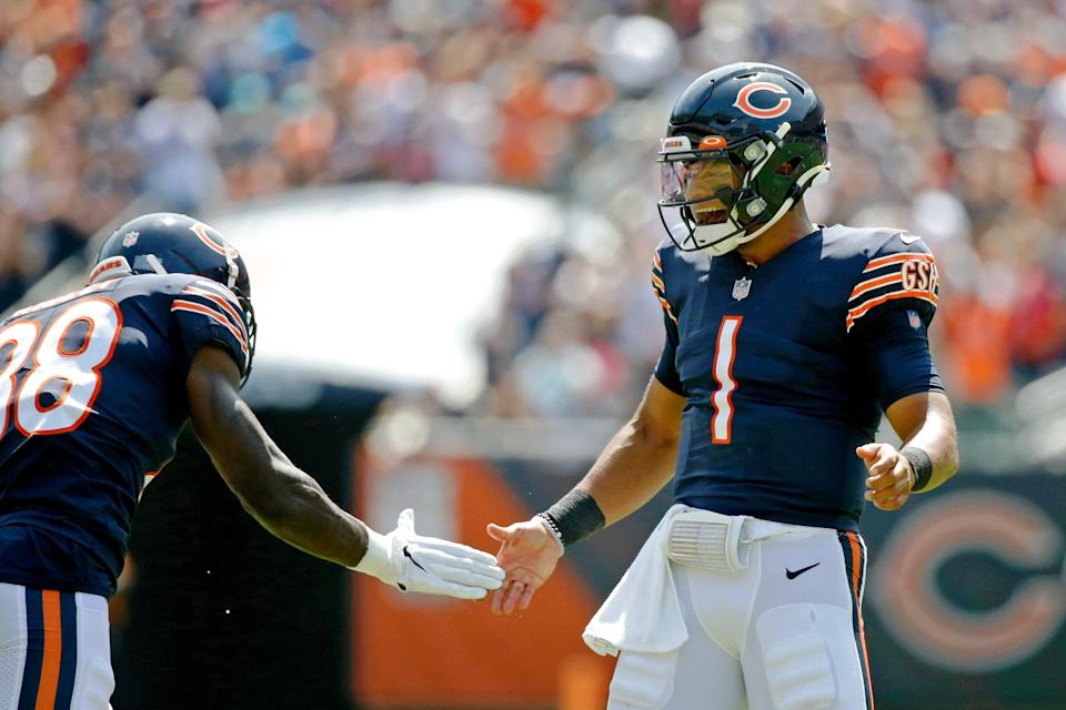 Chicago Bears quarterback Justin Fields (1) celebrates with wide receiver Riley Ridley (88) after throwing a touchdown pass to tight end Jesse James (not pictured) against the Miami Dolphins during the second half at Soldier Field.