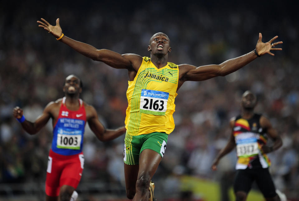 Usain Bolt, sporting Packers colors in 2008, wants Aaron Rodgers to stay in Green Bay. (Dylan Martinez / Reuters)