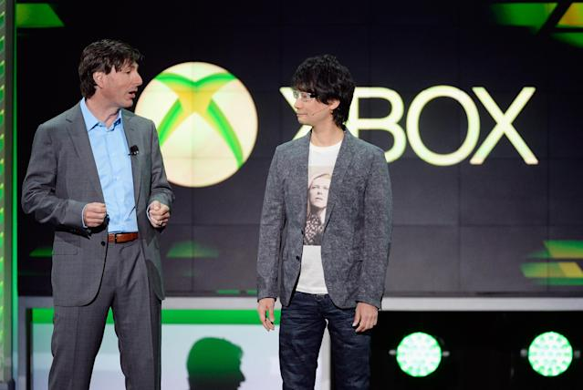 LOS ANGELES, CA - JUNE 10: Don Mattrick, (L) president of the Interactive Entertainment Business at Microsoft, and Japanese game director Hideo Kojima, head of Kojima Productions speak during Microsoft Xbox news conference at the Electronic Entertainment Expo at the Galen Center on June 10, 2013 in Los Angeles, California. Thousands are expected to attend the annual three-day convention to see the latest games and announcements from the gaming industry. (Photo by Kevork Djansezian/Getty Images)