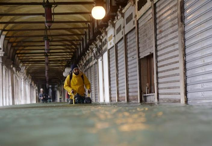 The renewed threat from exceptionally high tides in Venice came after a brief respite on Saturday (AFP Photo/Filippo MONTEFORTE )