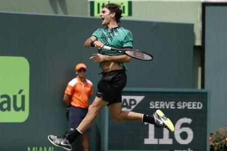 Apr 2, 2017; Key Biscayne, FL, USA; Roger Federer of Switzerland celebrates after winning match point against Rafael Nadal of Spain (not pictured) in the men's singles championship of the 2017 Miami Open at Crandon Park Tennis Center. Mandatory Credit: Geoff Burke-USA TODAY Sports