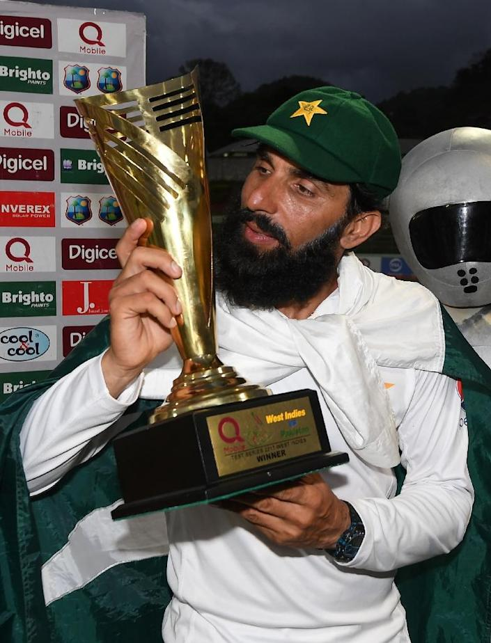 Retiring Pakistan cricket team captain Misbah ul Haq kisses the series trophy after winning the final test match and the series 2-1 against the West Indies at the Windsor Park Stadium in Roseau, Dominica (AFP Photo/MARK RALSTON)