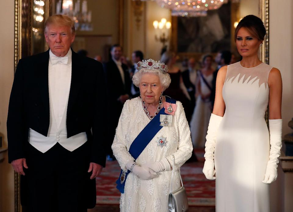 Melania Trump wore a Dior gown with elegant elbow-high gloves. [Photo: Getty]