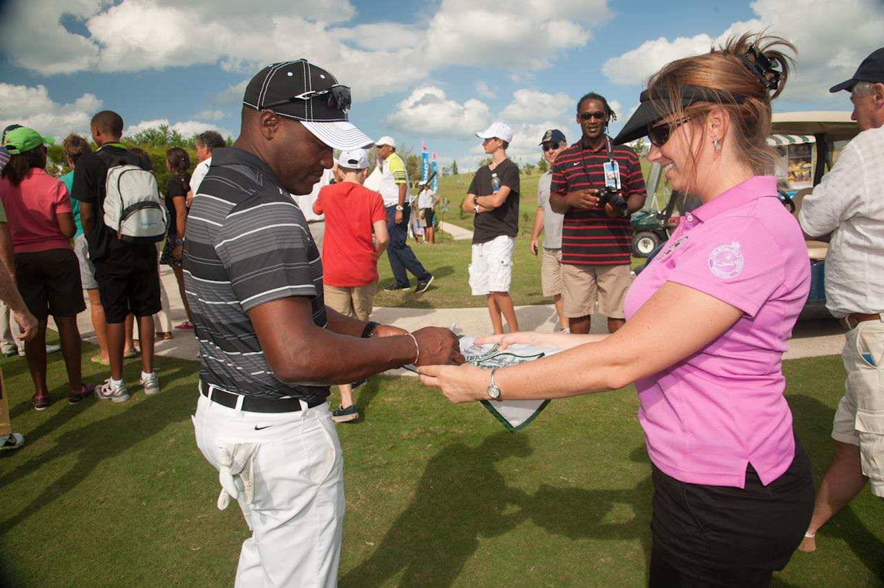 SOUTHAMPTON, BERMUDA - OCTOBER 22: Cricket Legend Brian Lara signs autographs during the Grand Slam Pro Am at The Port Royal Golf Club for the 30th Grand Slam of Golf on October 22, 2012 in Southampton, Bermuda. (Photo by Montana Pritchard/The PGA of America via Getty Images)
