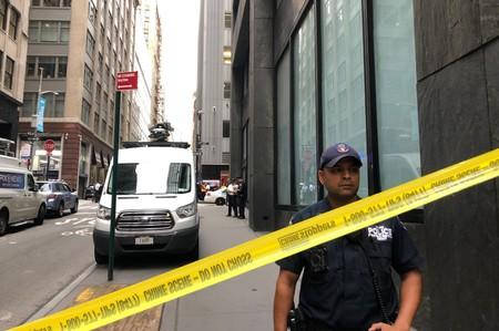 New York City police officers are seen as police said they were investigating two suspicious packages at the Fulton St. subway station in Manhattan