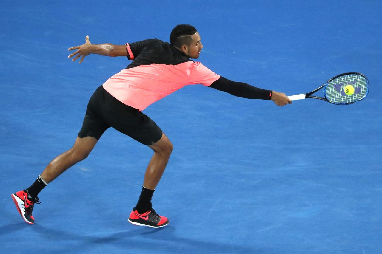 Tennis - Australian Open - Rod Laver Arena, Melbourne, Australia, January 21, 2018. Nick Kyrgios of Australia hits a shot against Grigor Dimitrov of Bulgaria. REUTERS/Issei Kato