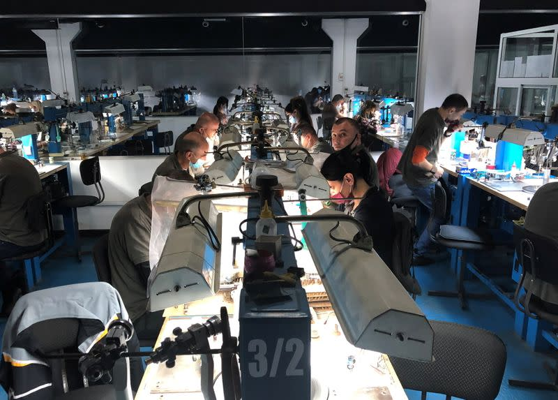 Employees work at a diamond-cutting factory in Abovyan