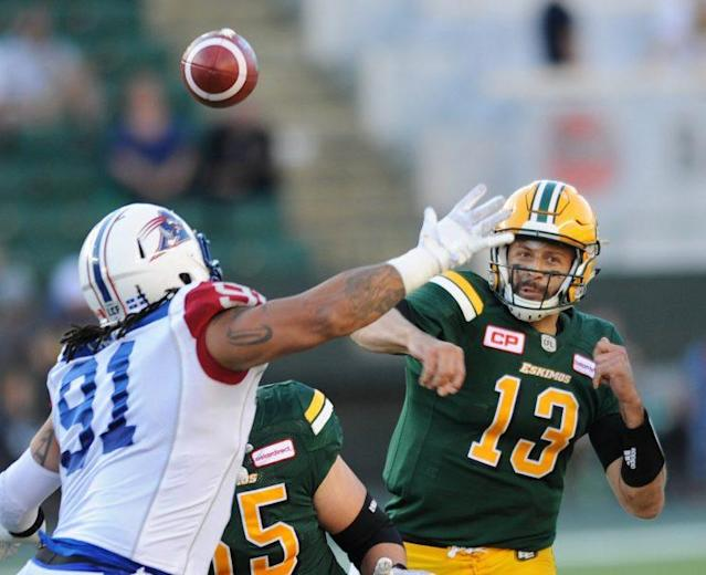 Edmonton quarterback Mike Reilly leads an offence that tops the CFL in a number of categories. (REUTERS/Dan Riedlhuber photo)