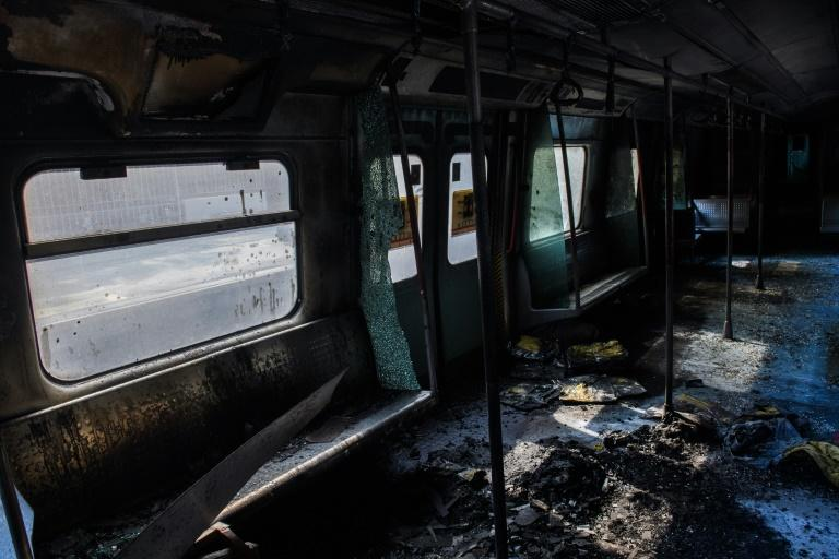 The protests severely disrupted public transport, with one metro carriage gutted by fire (AFP Photo/ANTHONY WALLACE)