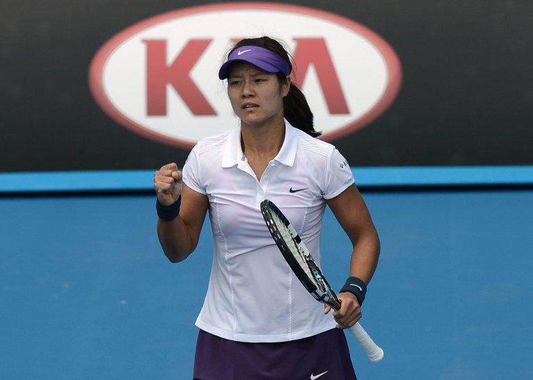 Li Na wins a point against Sesil Karatantcheva during their match at the Australian Open on January 14, 2013