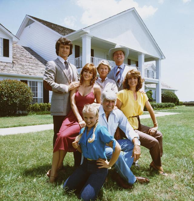 <em>Dallas</em> star Larry Hagman, back right, and the rest of the cast film at Southfork in 1979. (Photo: Copyright CBS Broadcasting Inc.)