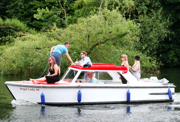 A boat makes its way along the River Thames towards Maidenhead Riverside on Sunday (Picture: PA)