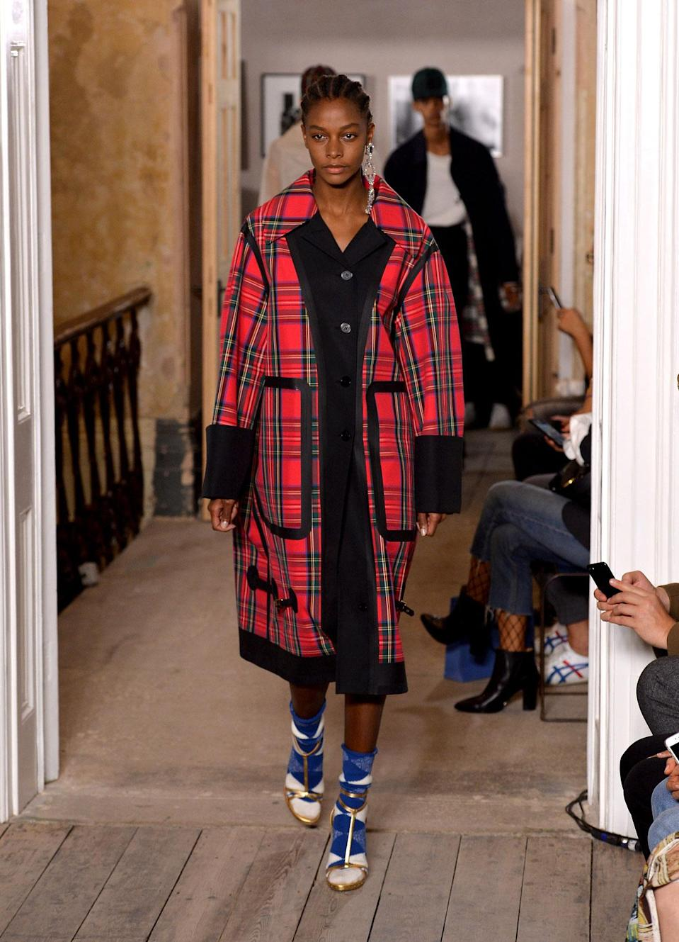 <p>Red plaid coat from the SS18 Burberry collection. (Photo: Getty) </p>