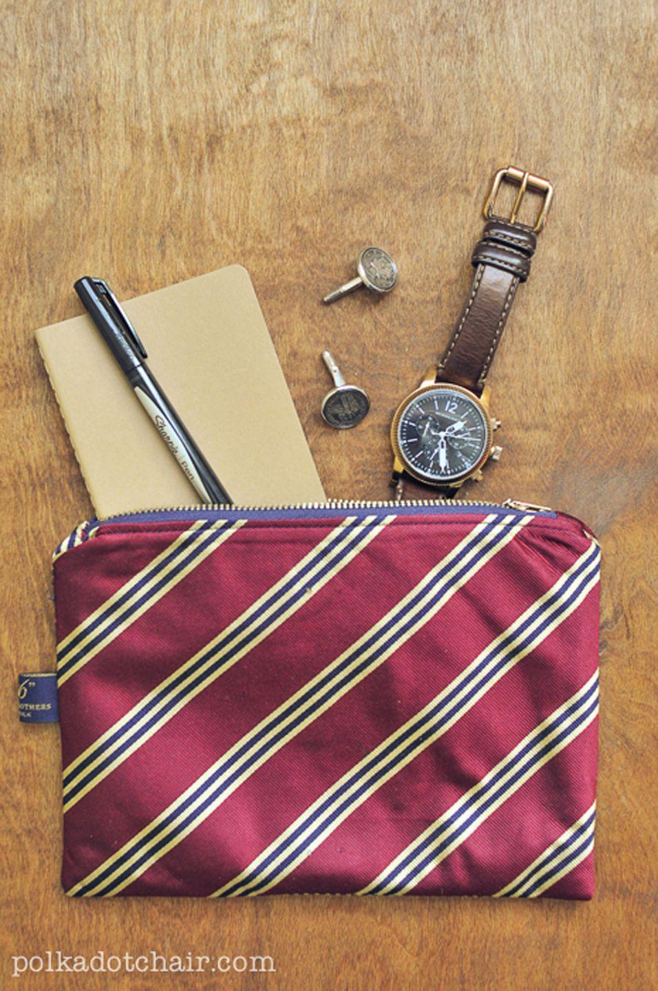 """<p>Transform a couple of Dad's old ties into a pouch that can hold all of his odds and ends. It's also nicely sized to act as a toiletry case if he frequently travels. </p><p><strong>Get the tutorial at <a href=""""https://www.polkadotchair.com/diy-necktie-zip-pouch/"""" rel=""""nofollow noopener"""" target=""""_blank"""" data-ylk=""""slk:Polkadot Chair"""" class=""""link rapid-noclick-resp"""">Polkadot Chair</a>.</strong></p><p><strong><a class=""""link rapid-noclick-resp"""" href=""""https://www.amazon.com/Coats-Thread-Zippers-F2107-013-All-Purpose/dp/B003W0S58Y?tag=syn-yahoo-20&ascsubtag=%5Bartid%7C10050.g.1171%5Bsrc%7Cyahoo-us"""" rel=""""nofollow noopener"""" target=""""_blank"""" data-ylk=""""slk:SHOP ZIPPERS"""">SHOP ZIPPERS</a></strong></p>"""