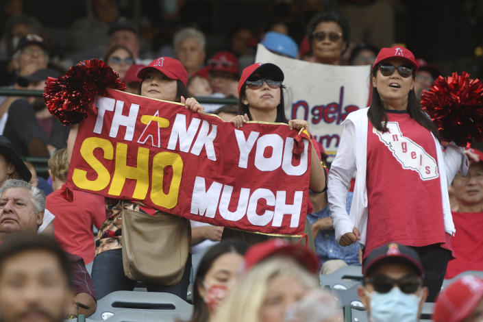 Los Angeles Angels' fans holds a sign thanking pitcher Shohei Ohtani during the Angels' final home game against the Seattle Mariners, Sunday, Sept. 26, 2021, in Anaheim, Calif. The Mariners won 5-1. (AP Photo/Michael Owen Baker)