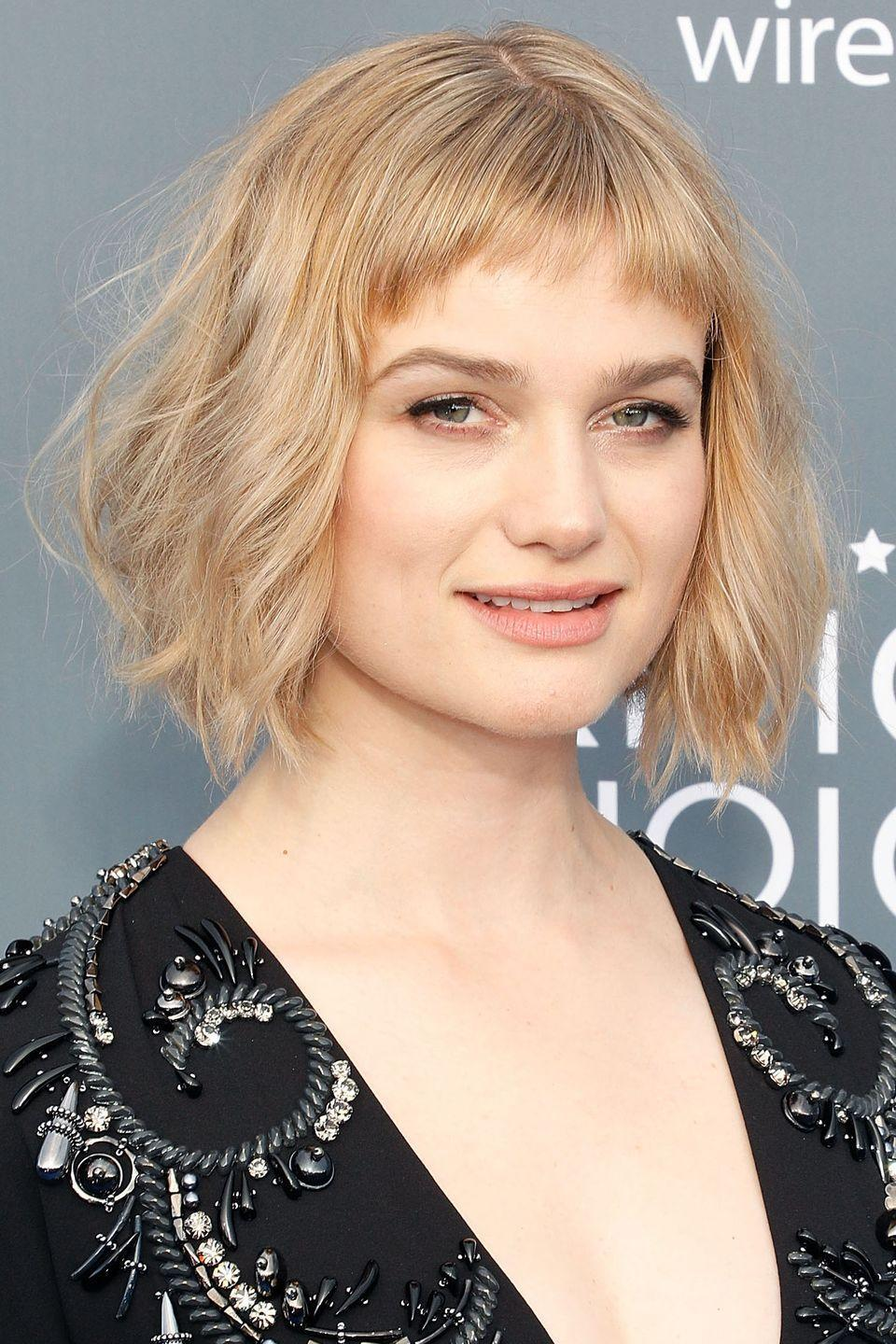 """<p>The choppy nature of Alison Sudol's short bangs works perfectly with her wavy, <a href=""""https://www.goodhousekeeping.com/beauty/hair/g1813/celebrity-hairstyles-bobs/"""" rel=""""nofollow noopener"""" target=""""_blank"""" data-ylk=""""slk:angled bob"""" class=""""link rapid-noclick-resp"""">angled bob</a>.</p>"""