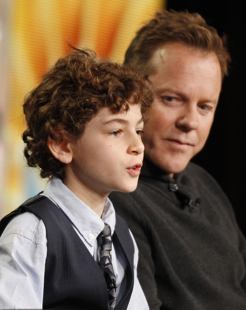 "Executive producer and cast member Kiefer Sutherland, right, and co-star David Mazouz participate in the panel discussion for the Fox television show ""Touch"" at the Fox Broadcasting Company Television Critics Association Winter Press Tour in Pasadena, Calif., on Sunday, Jan. 8, 2012. (AP Photo/Danny Moloshok)"