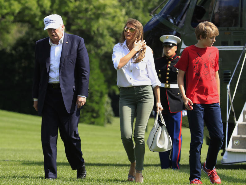 President Donald Trump, first lady Melania Trump and their son Barron Trump walk on the South Lawn upon arrival at the White House in Washington, Sunday, June 18, 2017, from Camp David in Maryland. (AP Photo/Manuel Balce Ceneta)