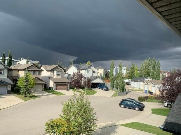 Threatening storm clouds loom over Coventry Hills, in north Calgary, shortly after 5 p.m. Tuesday. (Tim Propp/CBC - image credit)