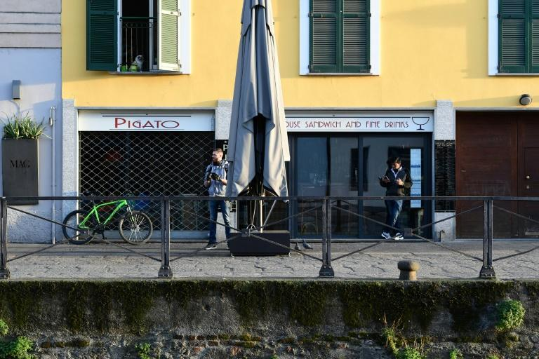 All restaurants and bars across Italy have to shut by evening and can only offer home deliveries (AFP Photo/Miguel MEDINA)