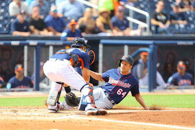 <p>Minnesota Twins Nick Buss (64) is tagged out at home plate by Houston Astros catcher Tim Federowicz (43) in the second inning of a baseball game at the Ballpark of the Palm Beaches in West Palm Beach, Fla., on Feb. 28, 2018. (Photo: Gordon Donovan/Yahoo News) </p>