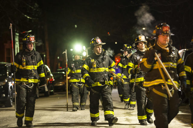 <p>Firefighters leave after putting out a major house fire on Prospect avenue on December 28, 2017 in the Bronx borough of New York City. (Photo: Amir Levy/Getty Images) </p>