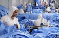 FILE PHOTO: Workers are seen in a factory that produces sterilised surgical equipment and medical clothings in Egypt
